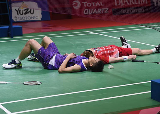 Both Chou Tien Chen (L) and Anders Antonsen lying on the court after an incredible match. (photo: Xinhua/Zulkarnain)