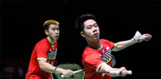 Bidder offers USD $2552.31 for Kevin Sanjaya Sukamuljo's (R) racquet. (photo: AFP)