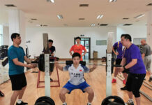Shi Yuqi is doing a leg workout. (photo: Xinhua)