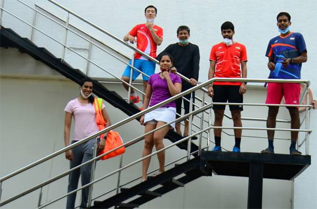 P.V. Sindhu (front left), women's doubles specialist N. Sikki Reddy, World Championship bronze medallist B. Sai Praneeth are at the Gopi Chand Academy in Hyderabad on Friday. (photo: thehindu)