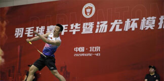 Chen Long takes the Fighting Dragon team over the Eagle team in the Thomas Cup simulation. (photo: Xinhua)