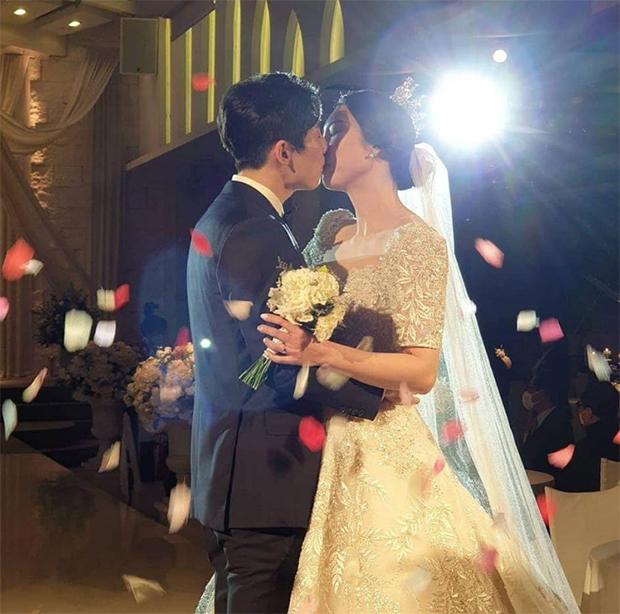 Son Wan Ho and Sung Ji Hyun embrace and kiss. (photo: Instagram)
