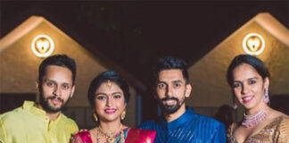 Parupalli Kashyap (left) and Saina Nehwal (right) attend the wedding of RMV Gurusai Dutt (second from right). (photo: Saina Nehwal's Facebook)