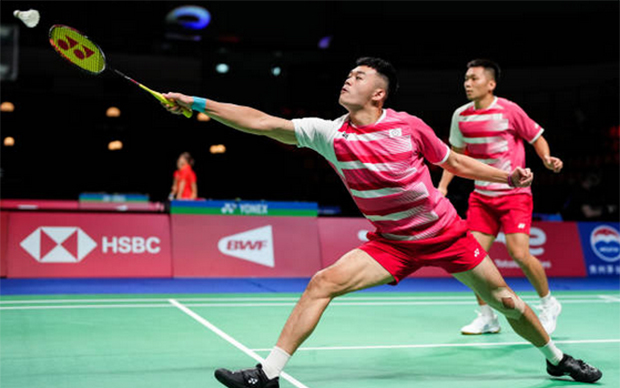 Lee Yang/Wang Chi-lin score the second point for Chinese Taipei against Thailand. (photo: Shi Tang/Getty Images)
